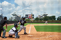 GCL Yankees East left fielder Raymundo Moreno (13) follows through on a swing in front of GCL Yankees West catcher David Vergel (5) and home plate umpire Rene Gallegos during the second game of a doubleheader against the GCL Yankees West on July 19, 2017 at the Yankees Minor League Complex in Tampa, Florida.  GCL Yankees West defeated the GCL Yankees East 3-1.  (Mike Janes/Four Seam Images)