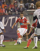 SL Benfica midfielder Ruben Amorim (5) passes the ball. SL Benfica  defeated New England Revolution, 4-0, at Gillette Stadium on May 19, 2010.