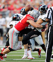 Ohio State Buckeyes defensive lineman Joey Bosa (97) tackles Cincinnati Bearcats quarterback Gunner Kiel (11) causing a fumble that led to a safety during the first quarter of Saturday's NCAA Division I football game at Ohio Stadium in Columbus on September 27, 2014. (Columbus Dispatch photo by Jonathan Quilter)