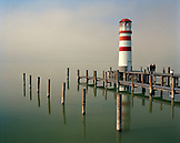 AUSTRIA, Podersdorf, people visit a lighthouse in the fog, Lake Neusiedler See, Burgenland