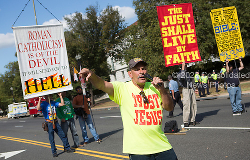 A group of men demonstrate with anti-Catholic slogans near The White House in Washington DC where United States President Barack Obama hosted an Official State Welcome ceremony for Pope Francis on Wednesday, September 23, 2015.  <br /> Credit: Chris Kleponis / CNP