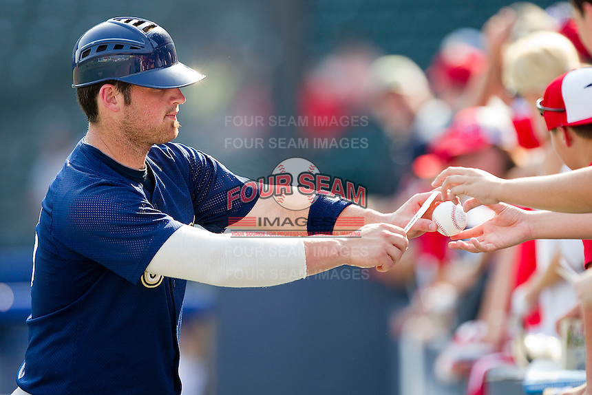 Derek Norris #25 of the Harrisburg Senators signs autographs prior to the game against the Richmond Flying Squirrels in game one of a double-header at The Diamond on July 22, 2011 in Richmond, Virginia.  The Squirrels defeated the Senators 3-1.   (Brian Westerholt / Four Seam Images)