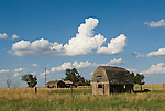 Abandoned wooden barn and homestead on the Great Plains of Colorado.