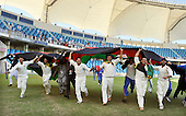 A lap of honour under the Aghanistan flag for their players after the vitory over Scotland - in the Intercontinental Cup final match at Dubai ICC Sports City Cricket Ground - picture by Donald MacLeod 04.12.10 - mobile 07702 319 738 - clanmacleod@btinternet.com - www.donald-macleod.com