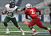 Nick Silva #23 of Floyd, left, stiffarms Jayvian Allen #2 of Freeport as he carries downfield during the Class I Long Island Championship at Shuart Stadium in Hempstead on Saturday, Nov. 24, 2018.