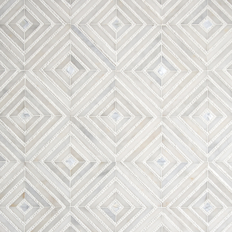 Bryce, a hand-cut stone mosaic, shown in honed Afyon White, tumbled Thassos and Shell by New Ravenna.
