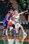 Texas Arlington Mavericks guard Eboni Watkins (24) and North Texas Mean Green guard Laura McCoy (4) in action during the game between the Texas Arlington Mavericks and the North Texas Mean Green at the Super Pit arena in Denton, Texas. UTA defeats UNT 59 to 50...