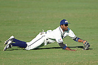 28 February 2010:  FIU's Pablo Bermudez (12) dives for a ball in left field as the FIU Golden Panthers defeated the Oral Roberts Golden Eagles, 7-6 (10 innings), at University Park Stadium in Miami, Florida.