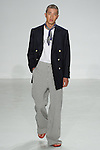 Model walks runway in a double breasted Admiral blazer, gowanus tee and Japanese stripe wide leg trouser, from the Palmiers du Mal Spring Summer 2017 collection by Brandon Capps and Shane Fonner, at Skylight Clarkson Square on July 14 2016, during New York Fashion Week Men's Spring Summer 2017.