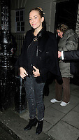 """SIENNA MILLER .Departed after the first preview performance of """"Flare Path"""", Haymarket, London, England, UK, 4th March 2011..full length black coat cape grey gray jeans denim .CAP/CAN.©Can Nguyen/Capital Pictures."""