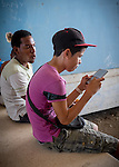 Havana, Cuba:<br /> Young gamers gathered on an afternoon off at the Ciudad Deportiva (Sport City)
