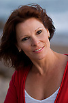 Mature woman at beach, smiling, close-up