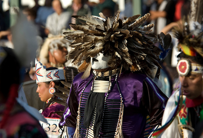 Traditional man's pow wow dancer dressed in a traditional Mandan feather headdress participants during Grand Entry in the dance arena on the Fort Berthold Indian Reservation, North Dakota
