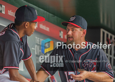 22 July 2016: Washington Nationals third base coach Bob Henley chats with Darren Baker in the dugout, prior to a game against the San Diego Padres at Nationals Park in Washington, DC. The Padres defeated the Nationals 5-3 to take the first game of their 3-game, weekend series. Mandatory Credit: Ed Wolfstein Photo *** RAW (NEF) Image File Available ***