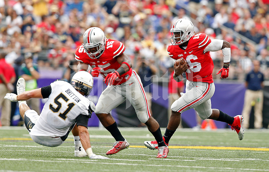Ohio State Buckeyes running back Ezekiel Elliott (15) knocks Navy Midshipmen linebacker James Britton (51) down to the ground on a Ohio State Buckeyes quarterback J.T. Barrett (16) run in the 4th quarter of their NCAA game at M&T Bank Stadium in Baltimore, Maryland on August 30, 2014. (Dispatch photo by Kyle Robertson)