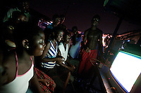children play 80s video games  while awaiting for the 50th anniversary of their countries' independence in the Jamestown neighborhood in Accra, Ghana on Sunday March 04 2007..