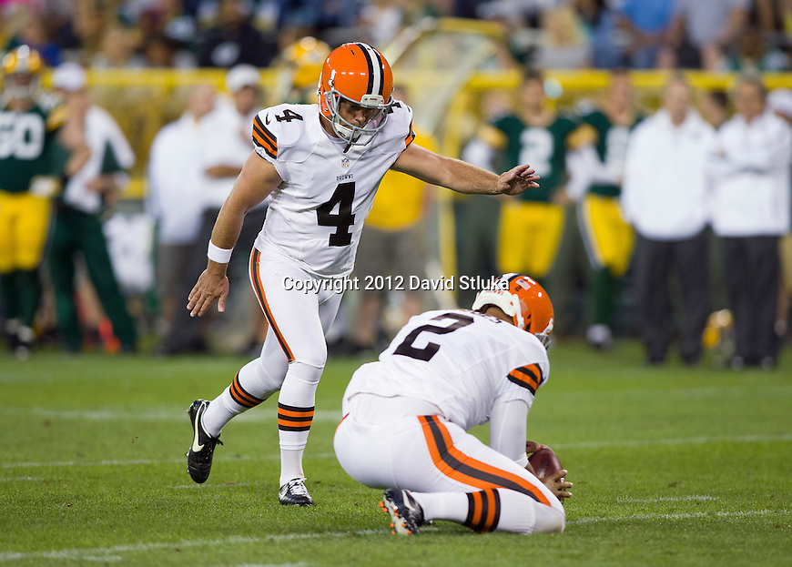 Cleveland Browns kicker Phil Dawson (4) attempts a field goal during an NFL preseason week 2 football game against the Green Bay Packers on August 16, 2012 in Green Bay, Wisconsin. The Browns won 35-10. (AP Photo/David Stluka)