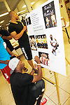 "Lamar K. Cheston signs poster- The National Black Theatre Festival during the full week of August 8, 2015 - The Layon Gray American Theatre Company presents ""Kings of Harlem"" written and directed by Layon Gray and starring him and the cast with performances at the festival. These photos are from the rehearsal at the Haynes Hosery Recreation Center, Winston-Salem, NC. The festival is an International Celebration and Reunion of Spirit. (Photo by Sue Coflin/Max Photos)"