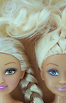 Close up of contemporary woman dolls with stereotypical big eyes long plaited blonde hair