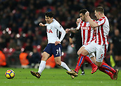 9th December 2017, Wembley Stadium, London England; EPL Premier League football, Tottenham Hotspur versus Stoke City; Son Heung-Min of Tottenham Hotspur passing the ball with Geoff Cameron and Kevin Wimmer of Stoke City in pursuit