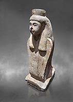Ancient Egyptian statue of the goddess Meretseger, limestone, New Kingdom, 19-20th Dynasty, (1480-1390 BC), deir el Medina. Egyptian Museum, Turin. Grey background. Cat 957.