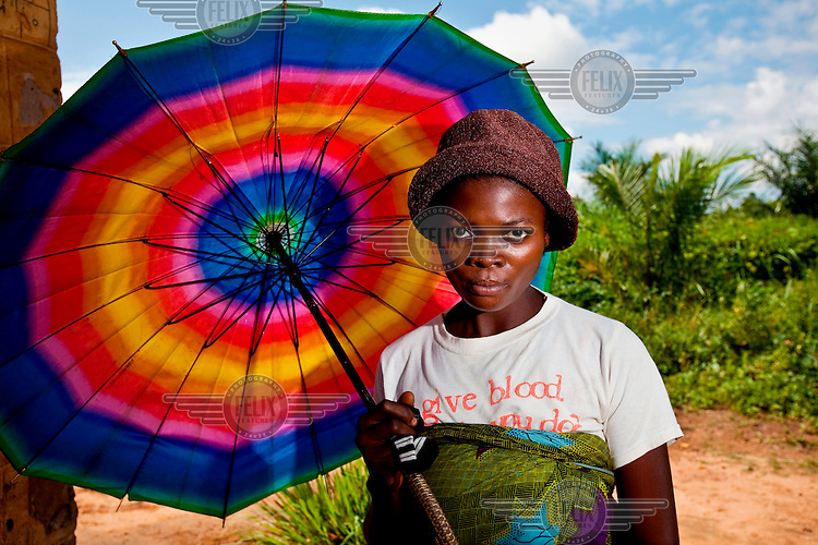A woman with colourful umbrella.