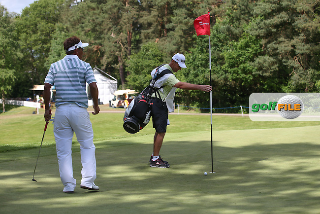 Thongchai Jaidee (THA) goes so close to a BMW car on the 14th during the Final Round of the BMW PGA Championship from Wentworth Golf Club, Virginia Waters, London, UK. Picture:  David Lloyd / www.golffile.ie