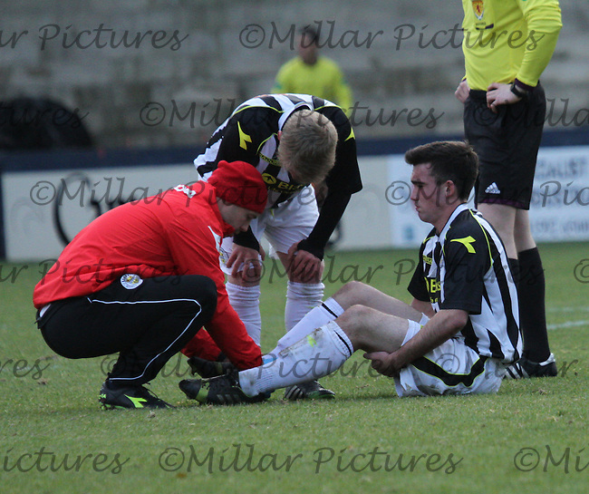 Stephen Mallon receives treatment for his injury in the Raith Rovers v St Mirren Scottish Football Association Youth Cup 4th Round match played at Stark's Park, Kirkcaldy on 24.11.13.