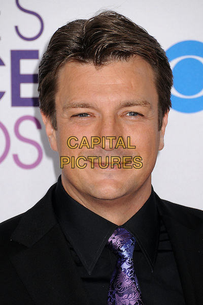 Nathan Fillion.People's Choice Awards 2013 - Arrivals held at Nokia Theatre L.A. Live, Los Angeles, California, USA..January 9th, 2013.headshot portrait blue shirt purple paisley black suit tie .CAP/ADM/BP.©Byron Purvis/AdMedia/Capital Pictures.