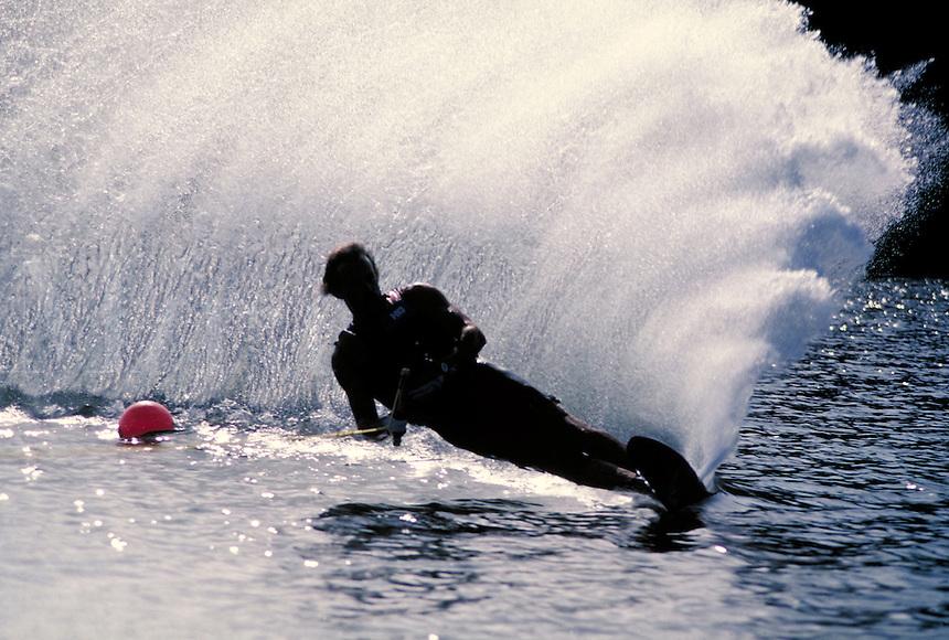 Man waterskiing silhouetted against spray. water skier. Birmingham Alabama United States.