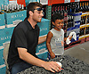 Steven Matz, New York Mets pitcher and Stony Brook native who graduated from Ward Melville High School in 2009, poses for a picture with a young fan before signing his baseball at Holbrook Liquors, located at 125 Beacon Drive, on Monday, Aug. 8, 2016.