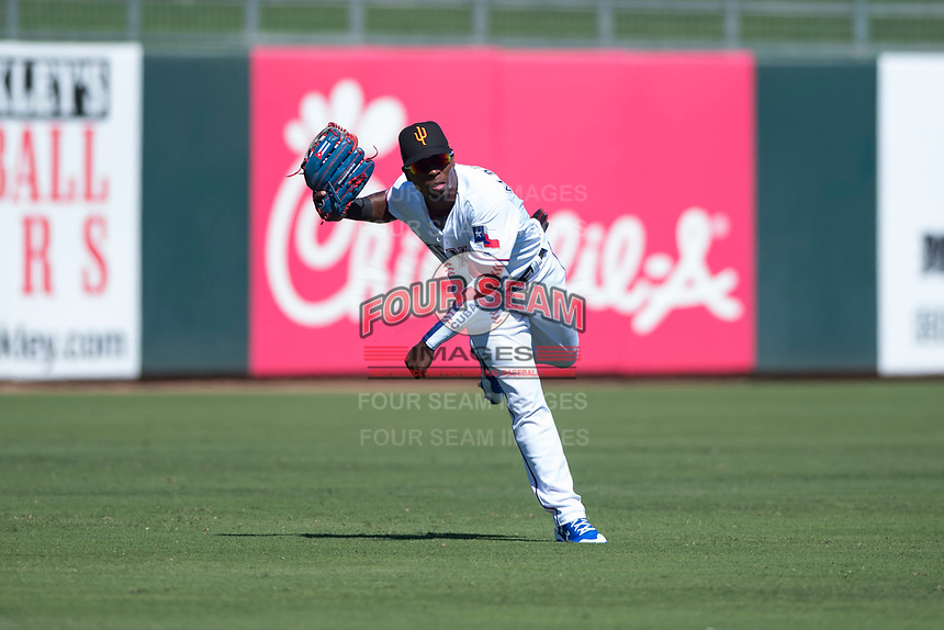 Surprise Saguaros outfielder Julio Pablo Martinez (40), of the Texas Rangers organization, follows through on a throw to home plate during an Arizona Fall League game against the Salt River Rafters on October 9, 2018 at Surprise Stadium in Surprise, Arizona. Salt River defeated Surprise 10-8. (Zachary Lucy/Four Seam Images)