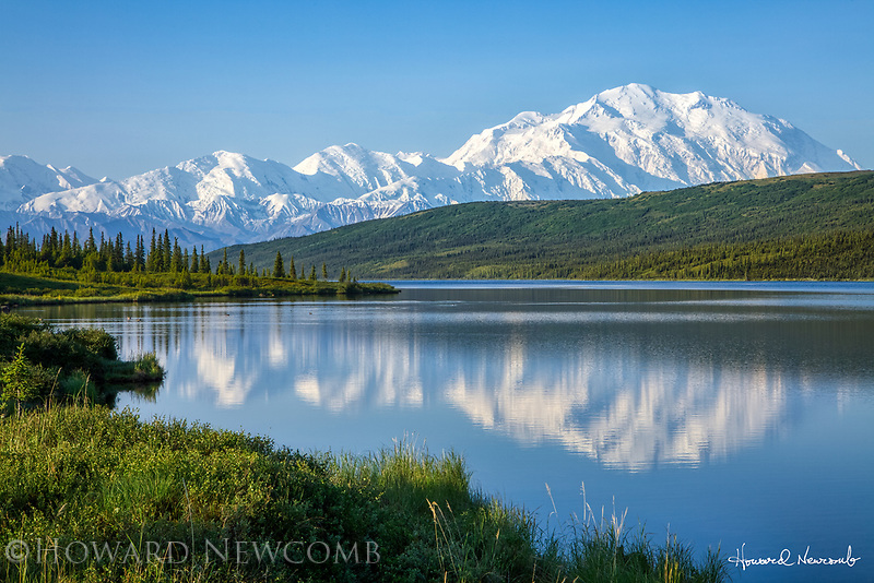 Mt. McKinley reflects in Wonder Lake on a clear summer morning in Denali National Park, Alaska.