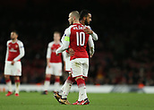 7th December 2017, Emirates Stadium, London, England; UEFA Europa League football, Arsenal versus BATE Borisov; Theo Walcott of Arsenal gives the captains arm band to Jack Wilshere of Arsenal as he is subbed off for Reiss Nelson of Arsenal