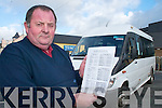 BUS: Brian O'Brien the driver of the new Killarney town bus checks out his timetable on Beech Road on Tuesday.   Copyright Kerry's Eye 2008