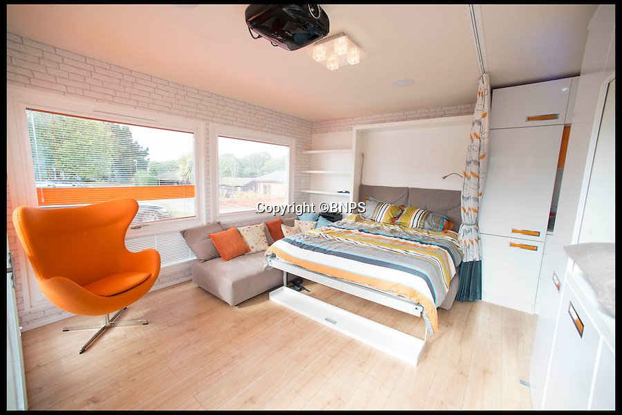BNPS.co.uk (01202 558833)<br /> Pic: LauraDale/BNPS<br /> <br /> The caravan's communal area, with the double bed folded down and interior wall bought forward into the room.<br /> <br /> A new mobile home that has movable walls to maximise the space the owner is using at the time is set to revolutionise the humble caravan holiday.<br /> <br /> The Concept Caravan measures 30ft by 13ft and uses the same area for different functions at different times.<br /> <br /> During the day, the movable bedroom wall is pushed back, freeing up an extra 60sq ft of room to create and impressive open-plan living space that has room for a 10 seater dining table.<br /> <br /> At night, the wall comes out and with it a foldaway bed to form a comfortable double bedroom.
