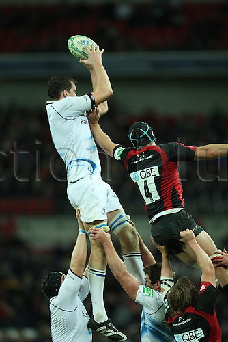 16.10.2010 Devin Toner (L) of Leinster get an high ball during a line out while Steve Borthwick of Saracens pushes him during the Heineken Cup Rugby match Saracens v Leinster at Wembley Stadium in London.