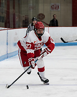 BOSTON, MA - FEBRUARY 16: Nara Elia #27 of Boston University on the attack during a game between University of New Hampshire and Boston University at Walter Brown Arena on February 16, 2020 in Boston, Massachusetts.