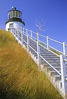 Owl's Head  Lighthouse sits and the end of a long walkway and stairs on top of a headland overlooking Penobscot Bay, Knox County, Maine