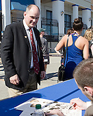Dan Hoene gets autographs from the Hobey Hat Trick members including Jack Connolly (UMD). - The members of the Hobey Hat Trick joined the Boston College Eagles and Ferris State Bulldogs at an autograph signing at Channelside Bay Plaza on Friday, April 6, 2012, in Tampa, Florida.