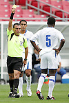11 March 2008: Referee Enrico Wijngaarde (SUR) shows a yellow card to Erick Norales (HON) (5). The Honduras U-23 Men's National Team defeated the Panama U-23 Men's National Team 1-0 at Raymond James Stadium in Tampa, FL in a Group A game during the 2008 CONCACAF's Men's Olympic Qualifying Tournament.
