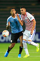 ARMENIA, COLOMBIA - JANUARY 19: Paraguay's Ivan Franco fights for the ball against Uruguay's Juan Sanabria during their CONMEBOL Pre-Olympic soccer game at Centenario Stadium on January 19, 2020 in Armenia, Colombia. (Photo by Daniel Munoz/VIEW press/Getty Images)