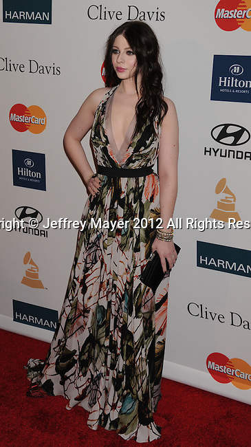 BEVERLY HILLS, CA - FEBRUARY 11: Michelle Trachtenberg arrives at the Clive Davis and The Recording Academy's 2012 Pre-GRAMMY Gala and Salute to Industry Icons Honoring Richard Branson at The Beverly Hilton Hotel on February 11, 2012 in Beverly Hills, California.
