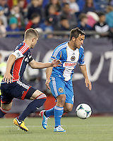 Philadelphia Union midfielder Danny Cruz (44) dribbles as New England Revolution defender Chris Tierney (8) defends.In a Major League Soccer (MLS) match, the New England Revolution (blue/red) defeated Philadelphia Union (blue/white), 2-0, at Gillette Stadium on April 27, 2013.