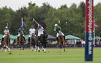 Pablo McDonough (Dubai Polo Team) hits a shot at goal during the Cartier Queens Cup Final match between King Power Foxes and Dubai Polo Team at the Guards Polo Club, Smith's Lawn, Windsor, England on 14 June 2015. Photo by Andy Rowland.
