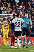 14th February 2020; Mestalla, Valencia, Spain; La Liga Football,Valencia versus Atletico Madrid; Referee Medie Jimenez show a yellow card to Maxi Gomez of Valencia CF