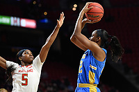 College Park, MD - March 25, 2019: UCLA Bruins guard Kennedy Burke (22) shoots a jump shot over Maryland Terrapins guard Kaila Charles (5) during second round game of NCAAW Tournament between UCLA and Maryland at Xfinity Center in College Park, MD. UCLA advanced to the Sweet 16 defeating Maryland 85-80.(Photo by Phil Peters/Media Images International)