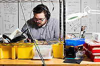 Guillermo Bernal is a graduate student and research assistant in the Fluid Interfaces Group led by Pattie Maes at MIT's Media Lab in Cambridge, Massachusetts, USA, seen here on Tues., April 25, 2017. Bernal is working on circuit design here for analog sensing of physiological changes to the human body experienced when using a virtual reality apparatus. He has worked on a VR experience called EmotionalBeasts and a sensor system called PhysioHMD that works with a VR device to sense changes to skin resistance, body temperature, and other physiological factors.