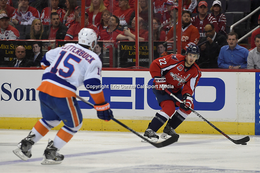 April 15, 2015 - Washington D.C., U.S. -  Washington Capitals left wing Curtis Glencross (22) carries the puck into the offensive zone during game 1 of the  NHL Eastern Conference Quarter finals between the New York Islanders and the Washington Capitals held at the Verizon Center in Washington DC. The Islanders defeat the Capitals  4-1 in regulation time. Eric Canha/CSM