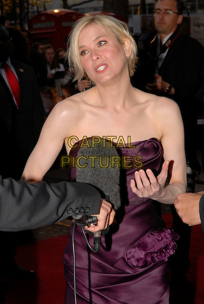 "RENEE ZELLWEGER .Attending the ""Leatherheads"" European Film Premiere held at the Odeon cinema, Leicester Square London, England, 8th April 2008..half length strapless hand purple dress funny  microphone being interviewed .CAP/IA.©Ian Allis/Capital Pictures"